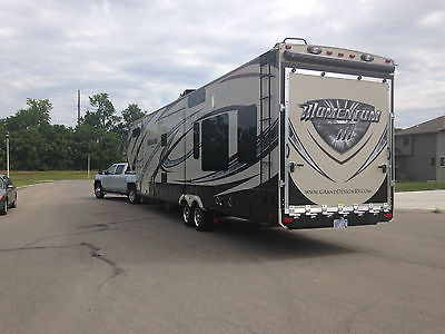 2014 Grand Design Momentum 385 TH 5th Wheel Toy Hauler (Truck Optional)