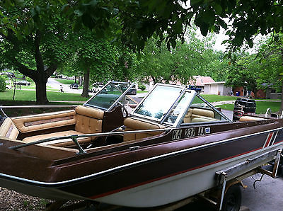 1979 Ebko fiberglass, tri-hull cimarron boat with trailer and 100 hp outboard.