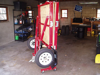 4'x8' fold utility trailer. Folds up for easy, convenient winter storage.