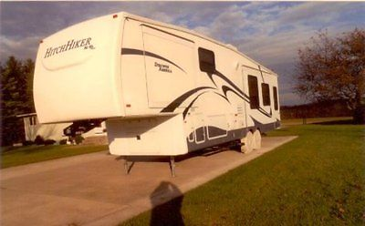10 Nu-Wa Discover America 327LK 5th Wheel Winterized 3 Seasoned Non Smoking