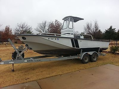 23'  Boston Whaler Center Console with 10k tandem trailer, needs motor
