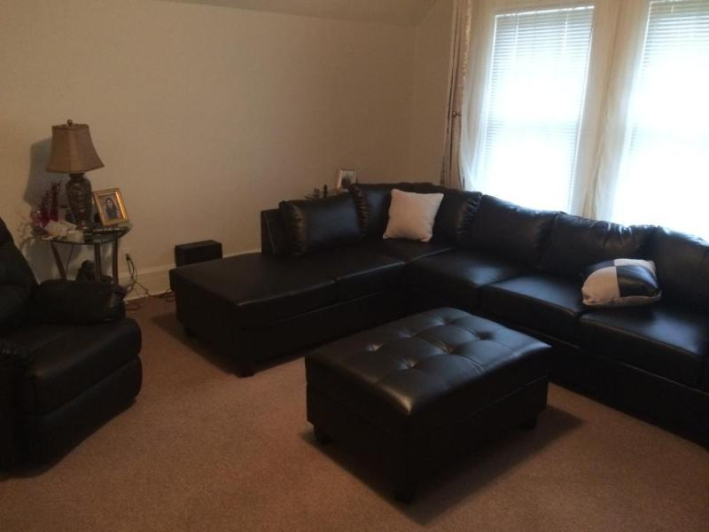 Used but inSofas black leather with ottoman with storage compartment