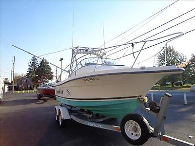 00 Trophy 2052 Fishing boat with 2006 Yamaha 9.9 kicker motor