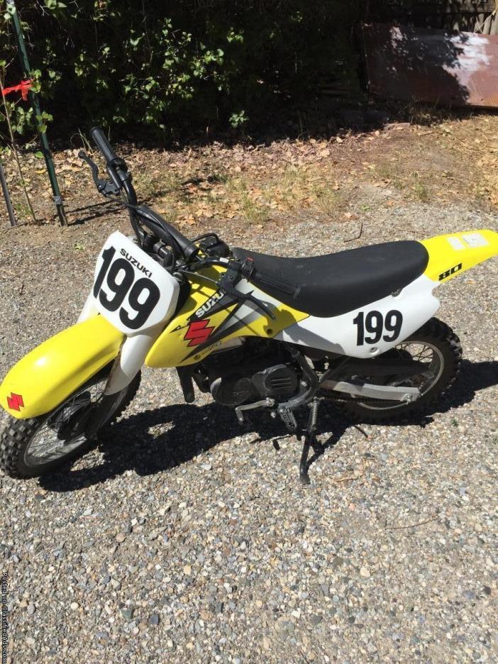 Suzuki yellow white and black motocross dirt bike