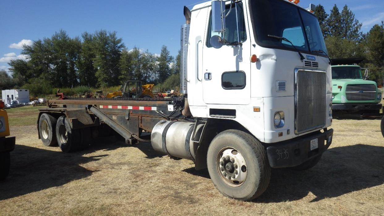 1992 White Gmc N14-330e  Roll Off Truck