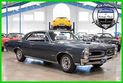 1966 Pontiac GTO  1966 pontiac gto 389 ci 3 x 2 bbl 360 hp v 8 4 speed manual numbers matching 66