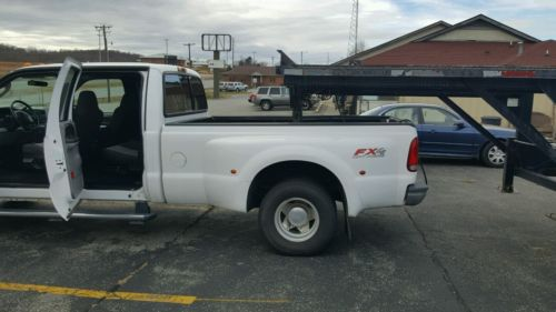 combo 2004 Ford 350 dually and a 2006 Kaufman 3/4 car hauler