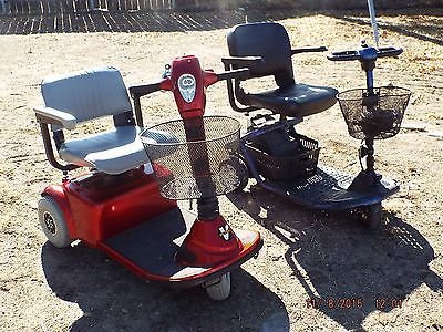 Two scooters. A Blue Golden Light Rider and a Red Pride Deluxe