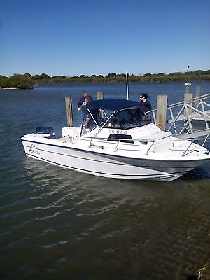 1991 Horizon Boat with cuddy cabin and V4 motor