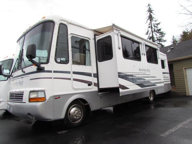 1999 33' NEWMAR COUNTRY STAR 18K MILES 2 SLIDE