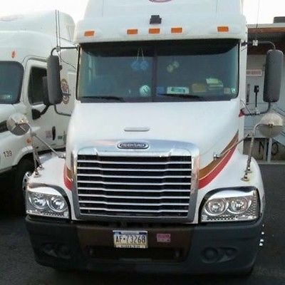 2005 white freightliner tractor with gold and red stripes