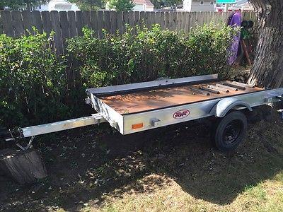 Snowmobile single place tilt trailer