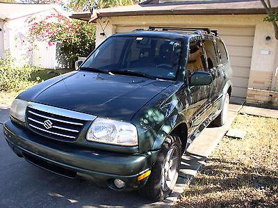 2001 Suzuki Grand Vitara Luggage rack. 2001 SUZUKI GRAND VITARA - XL-7 , FOUR WHEEL DRIVE - SUV - 5 SPEED MANUAL TRAN.