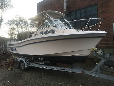 1997 Grady White 226 Seafarer Fishing BOAT with 2005 Load Rite Roller Trailer