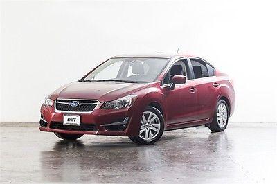 2015 Subaru Impreza 2.0i Premium 2015 Subaru Impreza 2.0i Premium 28845 Miles Red 4D Sedan 2.0L 4-Cylinder SMPI D