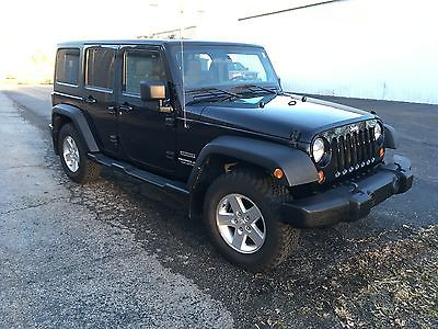 2011 Jeep Wrangler Unlimited Sport Sport Utility 4-Door 2011 Jeep Wrangler Unlimited Sport 4 Door 4x4 NICE TIRES NEW BATTERY NEW TOP