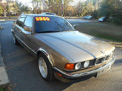 1989 BMW 7-Series leather 1989 BMW 750i, bronzit, red leather, V-12 purrs, runs and drives very well.