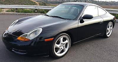 1999 Porsche 911 Carrera 4 AWD, 6 Speed 1999 Porsche 911 Carrera 153,225 Miles Black 2dr Car Flat 6 Cylinder Engine 3.4
