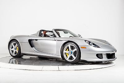 2004 Porsche Carrera GT Ascot Brown / Carbon Fiber 2004 Porsche Carrera GT V10 5.7L 605 HP 6-Speed Manual