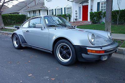 1979 Porsche 930 Turbo Coupe 2-Door 1979 Porsche 930 Turbo Coupe Mellatic Silver/Black 27,600 Original Miles 2 owner