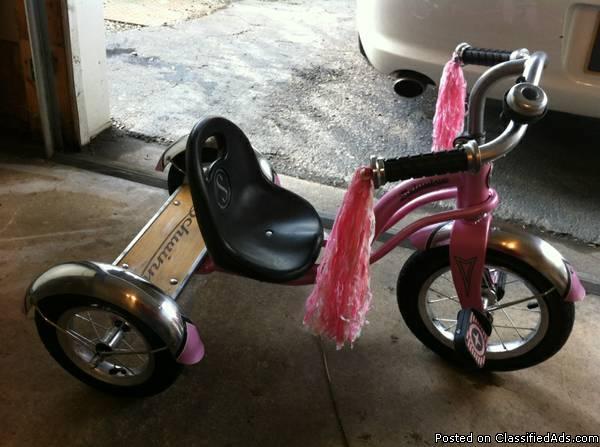 Pink Schwinn tricycle