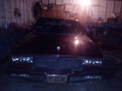 Cadillac : Fleetwood 1985 red cadillac fleetwoob bro very low milage see details