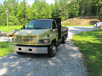 GMC C5500 truck w/asphalt sealing unit
