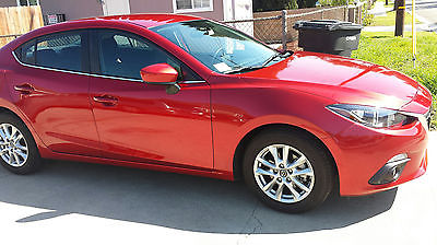 2015 Mazda Mazda3 i Touring 2015 Red Mazda MAZDA3 i Touring Sedan $14k under 15kmiles Still under Warranty!!