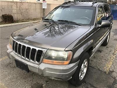 2000 Jeep Grand Cherokee Laredo 2000 Jeep Grand Cherokee Laredo 147,388 Miles Champagne Pearl Sport Utility Stra