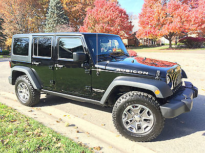 2016 Jeep Wrangler Unlimited Rubicon Sport Utility 4-Door 2016 Jeep Wrangler Rubicon Unlimited 4dr 4x4 Black on Black one owner 7k Miles