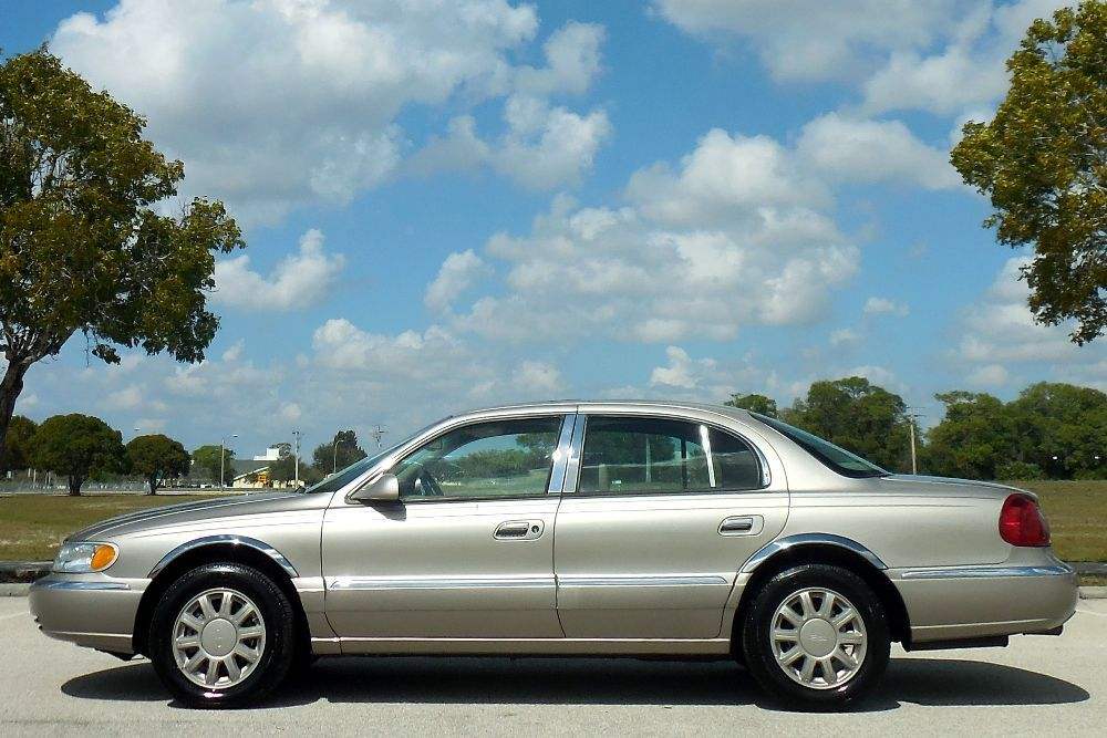 2002 Lincoln Continental FLORIDA CARFAX CERTIFIED LOW MILE DIAMOND!! HEATED SEATS~SUNROOF~MICHELINS~65K~LEATHER~PRISTINE WHEELS~NONE NICER~03 04 05