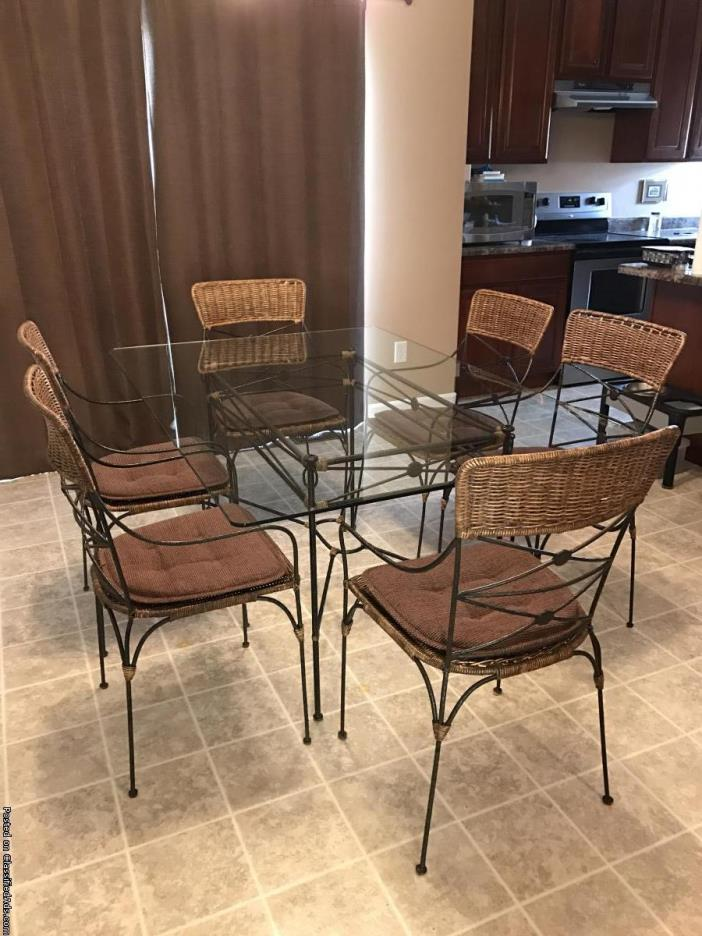 Glass top kitchen table and 6 chairs