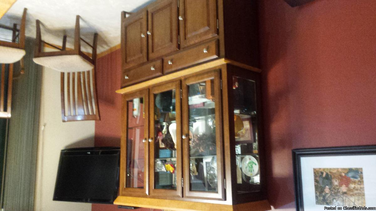 Table and 6 chairs with lighted hutch
