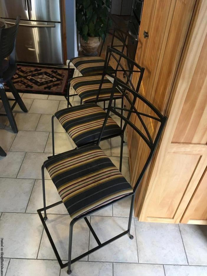 Four black iron bistro counter stools