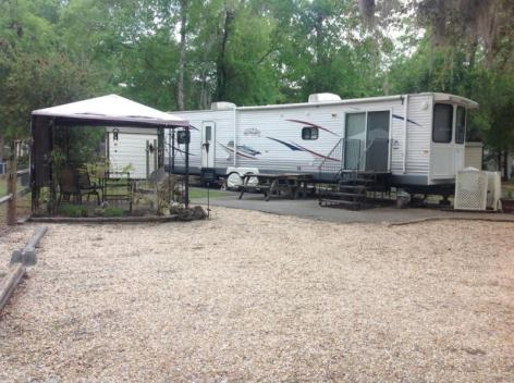 Escape to N FLA woods! in your RV PARK MDL all set on OWNED LOT no TOW