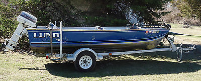 1989 Lund Rebel Special Fishing Boat with motor, trailer, and accessories