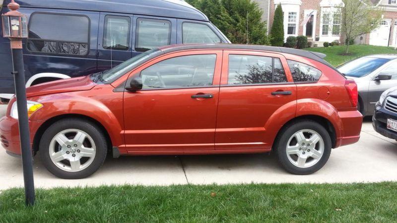 2008 Dodge Caliber Rust Exterior/Tan Interior 17,500 Mi.