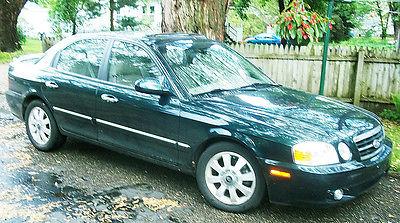 Kia : Optima EX 2004 kia optima ex v 6 very low mile age great condition fully loaded