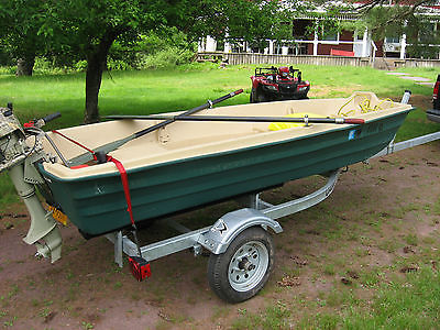 12 ft Coleman Jon boat 5 HP Briggs and Stratton outboard and Trailer and extras