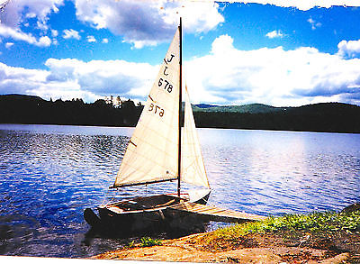 Wooden Blue Jay # 648 with sails, trailer, 2  rudders and more.