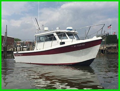 2004 OSPREY PILOTHOUSE 26 LONG CABIN DIESEL VOLVO PENTA LOADED LOW HOURS MUST C