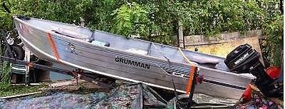 1990 Grumman DEEP-V 14ft rowboat with 1996 25hp mercury outboard $2250.00 OBO