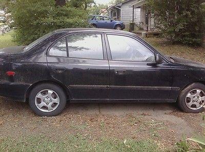 Hyundai : Accent Black Black 4- door
