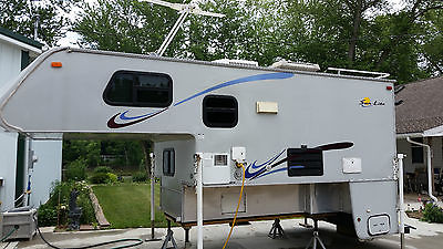 Truck Camper / queen size bed/ ref ac/dc/propane/full shower/ stove/mic wave