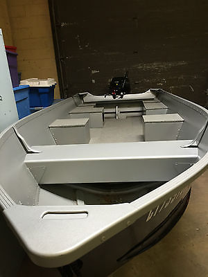 Alumacraft boat model V-14, Tohatsu outboard motor 20hp and easy loader trailer.