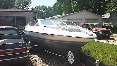 1990 Bayliner Capri boat with a 90 hp engine