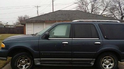Lincoln : Navigator 4 door, suv Blue, 3rd row seating, Leather, Sunroof, Heated Seats, CD Changer,