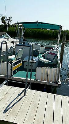 1996 Grumman  pontoon boat  with 70hp engine.