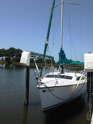Hunter 23.5 weekender sailboat with trailer. Solid condition. Many extras.