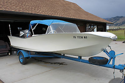 1961 American Marc Stardust with 1962 Evinrude outboard. Vintage outboard boat